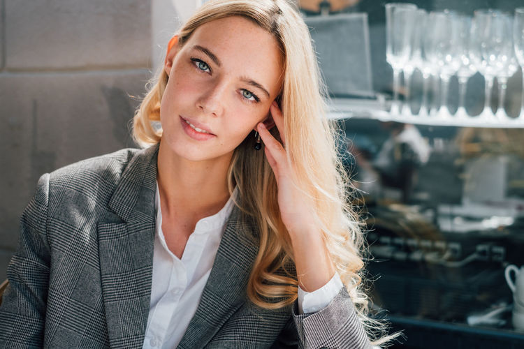 Portrait of a blond woman with beautiful eyes One Person Business Portrait Young Women Blond Hair Communication Business Person Beautiful Woman Hairstyle Entrepreneur Women Young Adult Front View Hair Sexygirl Pretty Girl Copy Space The Modern Professional