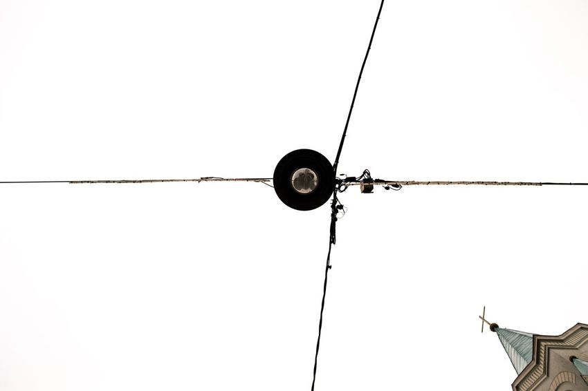 Wires Streetlight Church Minimalism Lookingup Whitebackground Contrast Urbanelements Crosses Latergram Negativespace negative space Looking Up Hanging Cable Silhouette Sky Electricity Pylon Power Cable Electrical Grid Bulb Light Bulb Power Line