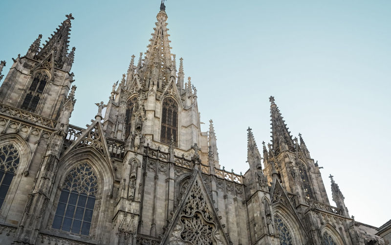 Barcelona Cathedral,Saint Eulalia, Building exterior. Low angle. Barcelona Cathedral Santa Eulàlia Cathedral Low Angle View Gothic Architecture Clear Sky No People Gothic Style Travel Destinations Famous Building Building Exterior Façade Place Of Worship Spirituality Building Built Structure Architecture Spire  Ornate Day Outdoors Religion Catholicism