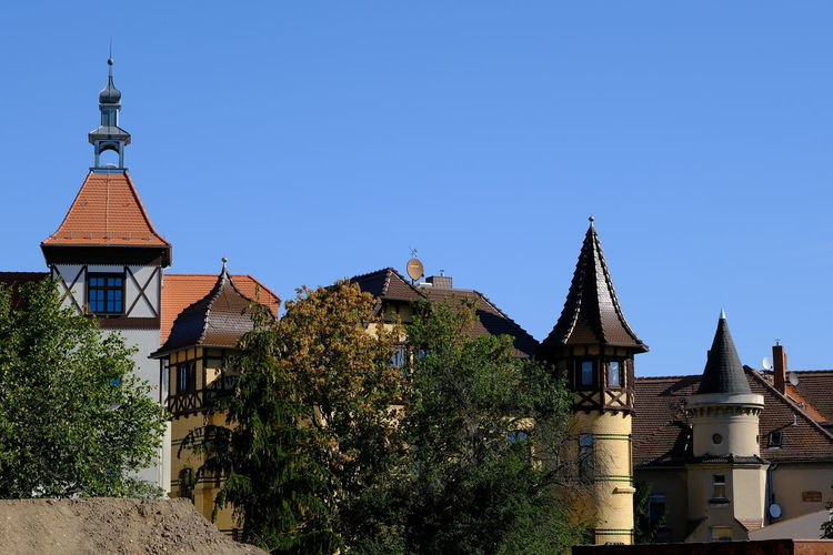 Traditional building against clear blue sky