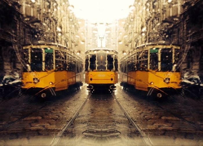Tramway Amidst Building During Monsoon