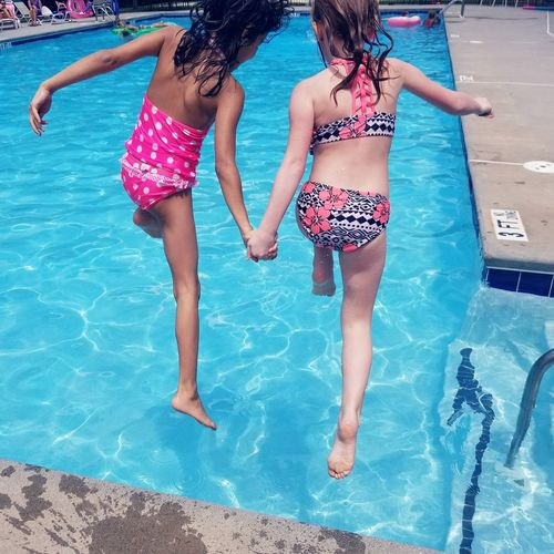 Girls Jumping In Swimming Pool