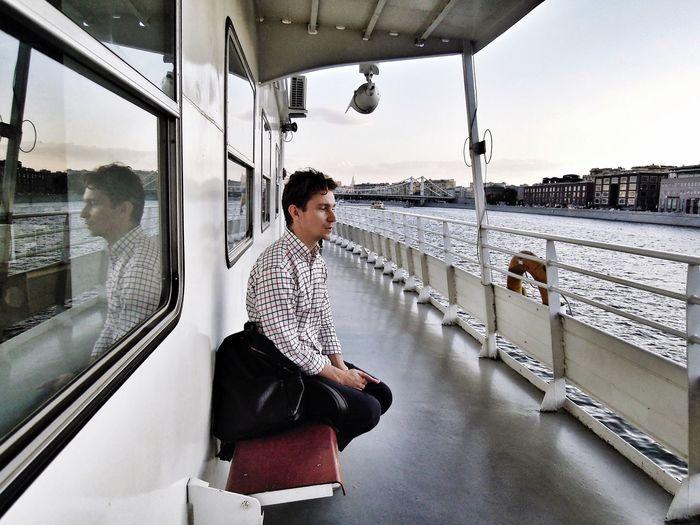 Man sitting on a nautical vessel