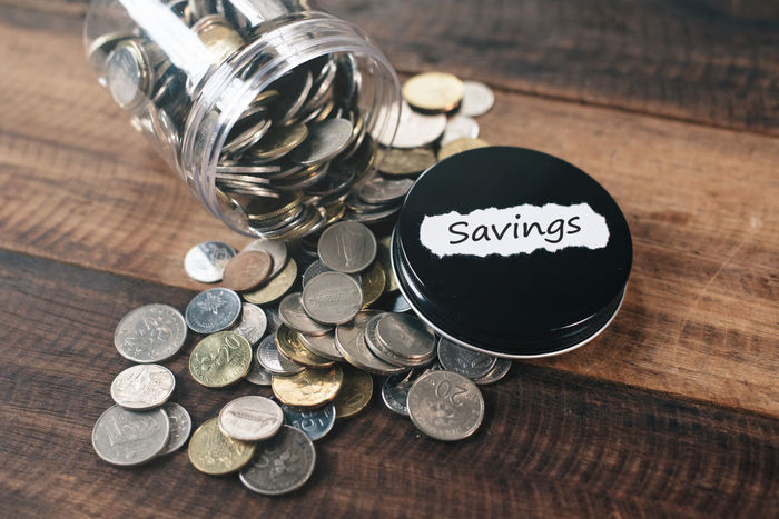 coins in jar. savings concept Benefit Currency Economy Life Cash Coins Collect Concept Day Deposit Finance Financial Future Investment Jar Malaysia Money Reserves Retirement Ringgit Save Savings Table Wealth Wooden