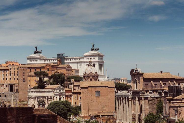 Altare Della Patria Amidst Buildings Against Sky In City