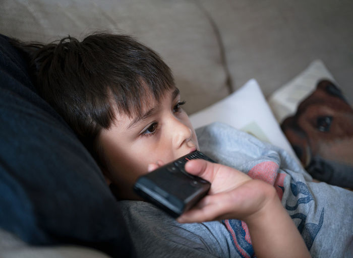 High angle view of boy using mobile phone
