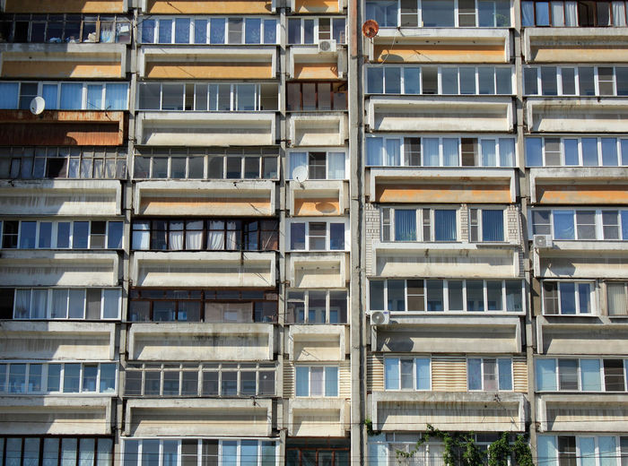 Background of windows and balconies of a multi-storey building