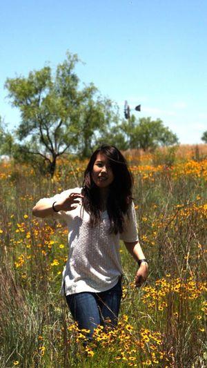 Portrait of a girl walking on landscape