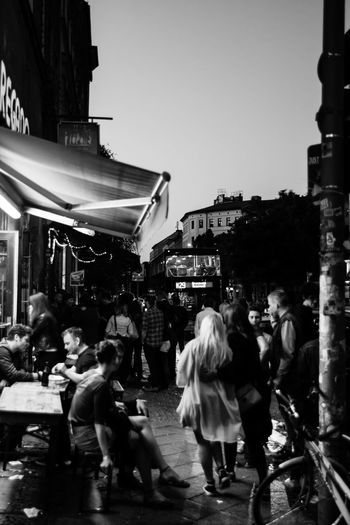 Bars And Restaurants Dress Architecture Blackandwhite Blond Hair Building Exterior City Crowd Large Group Of People Night Nightlife Outdoors People Real People Streetphotography Women Discover Berlin