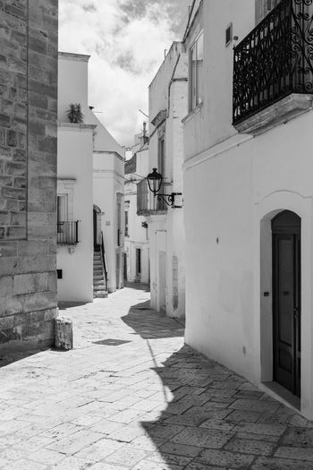 Walking through the streets of Locorotondo. Between white houses and dreamlike architecture. Puglia to love, Italy Architecture Built Structure Building Exterior Building No People Day Italy Trulli Trulli Houses Trulli Puglia Apúlia Puglia Puglia South Italy Stone Stone Material House Houses White White Color Typical Typical Houses Locorotondo Italian Travel Travel Destinations Travel Photography Europe Village Village Photography Itria Itria Valley Landmark Landmarkbuildings Roof Rural Scenes History History Architecture History Place Landscape Italia Traditional Old Old Buildings Old Town Residential Buildings Tourist Tourist Destination Tourist Attraction  Monument Nobody Picturesque Picturesque Village Picturesque Scenery Picturesque Place Picturesque Street Street Sunny Urban Tour Tourism Natural Stone The Art Of Street Photography My Best Photo