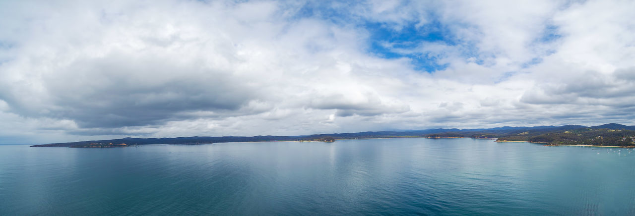 Minimalistic aerial panorama- nothing but water, patch of land, and skies Drone  Aerial Aerial Landscape Beauty In Nature Cloud - Sky Day Drone Photography Landscape Nature No People Outdoors Scenics Sea Sky Tranquil Scene Tranquility Water Waterfront