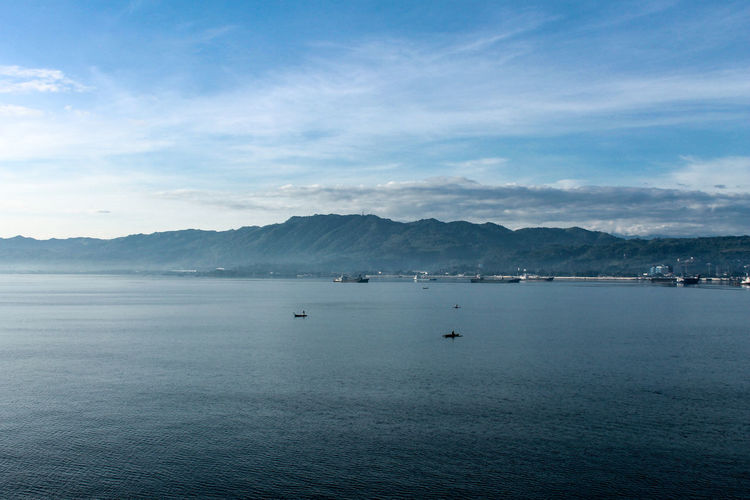Beauty In Nature Cloud - Sky Day Mountain Mountain Range Nature Nautical Vessel No People Non-urban Scene Outdoors Scenics - Nature Sea Sky Tranquil Scene Tranquility Transportation Travel Water Waterfront