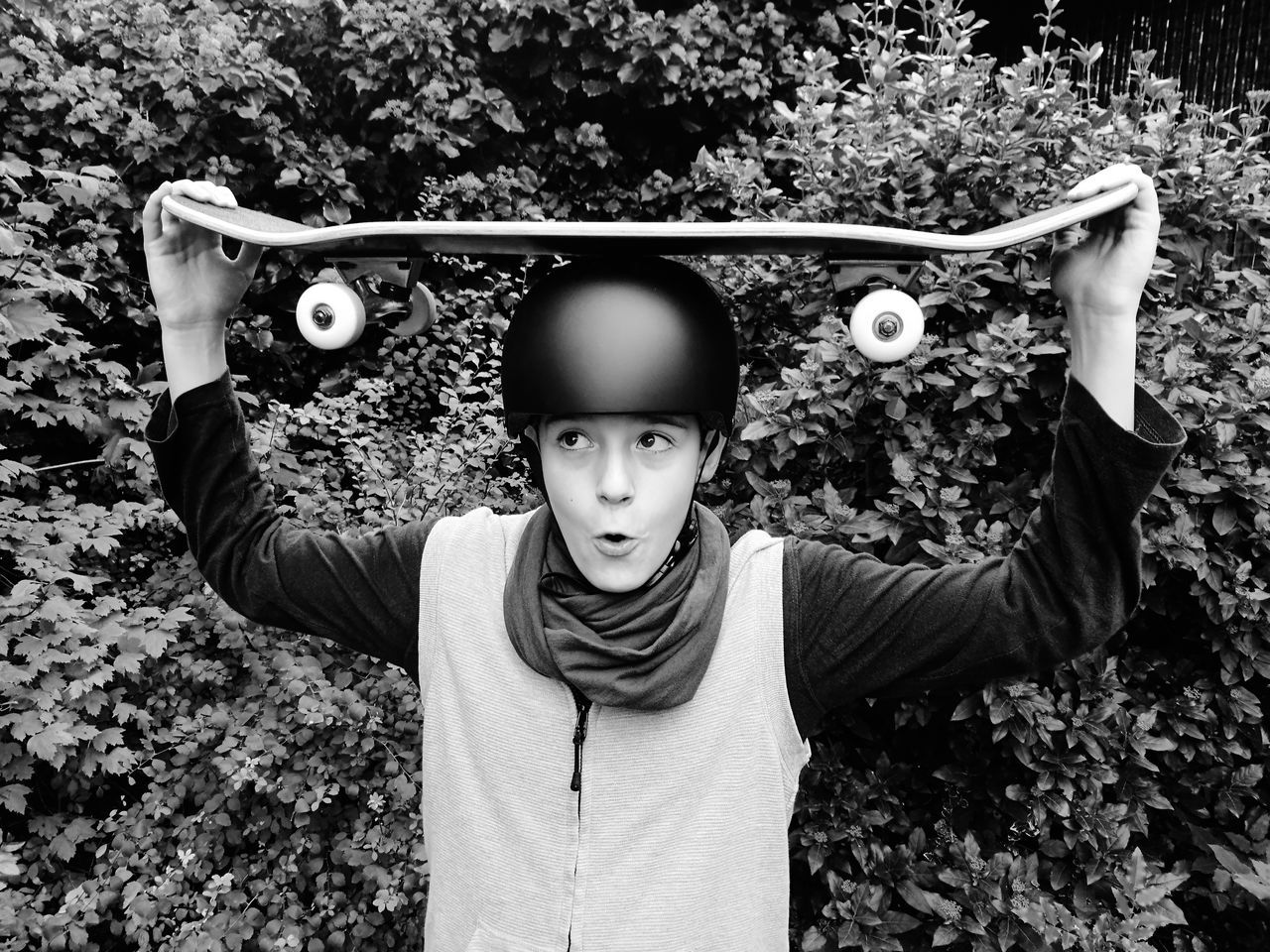 EyeEm Selects The Skateboarder Portrait Skateboarder Sports Helmet Outdoors Teenager Headwear Childhood Front View One Person Standing Waist Up Concentration Day Tree
