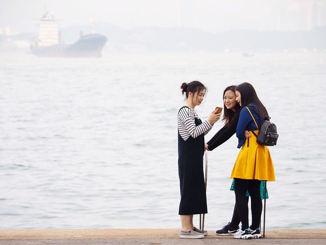 Togetherness Young Adult Young Women Leisure Activity Outdoors Three People Light And Shadow People Watching Capture The Moment Candid Candid Photography Olympus OM-D EM-1 Capturing The Moment Foggy Day People And Places Waterfront People Talking Nautical Vessel Focus On Foreground