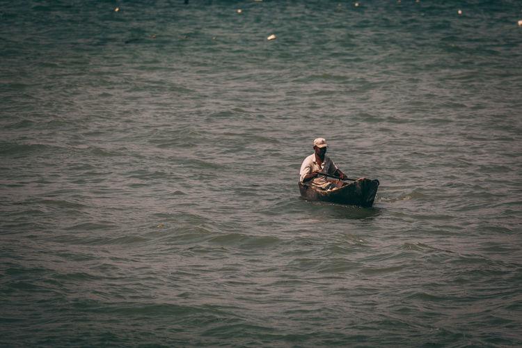 Man Boating On Sea