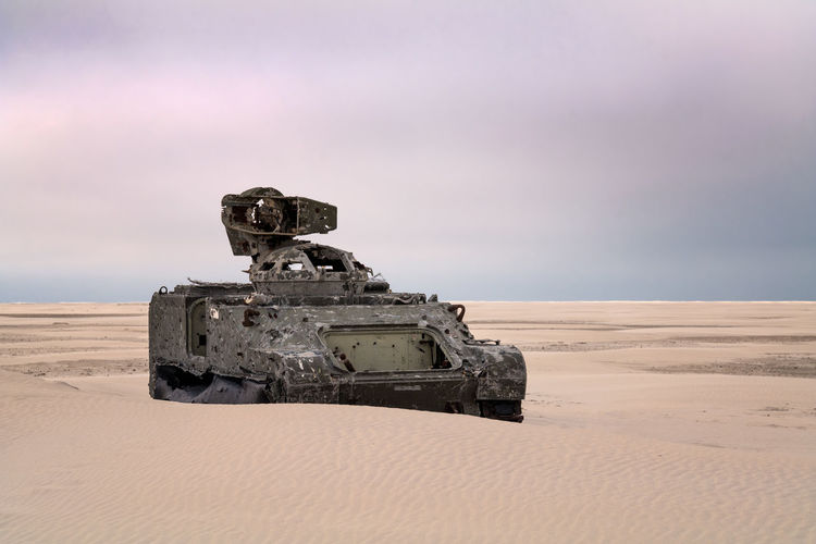 Army tank vehicle on the beach with bullet holes