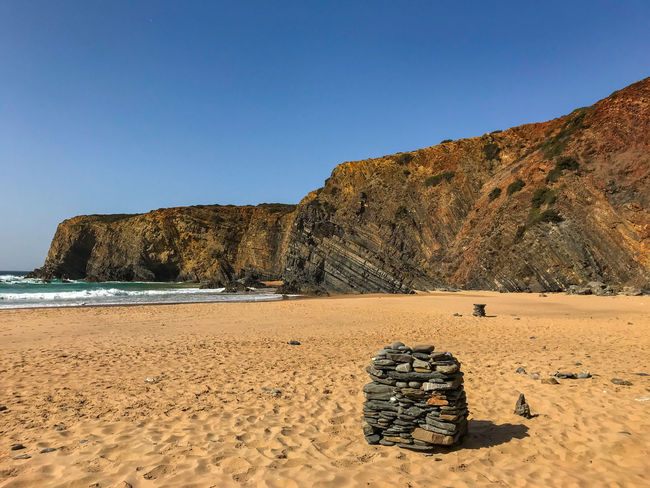 Clear Sky Nature Nature Photography Portugal Tranquility Travel Travel Photography Traveling Beach Beauty In Nature Blue Cavaleiro Cliff Day Nature_collection Naturelovers No People Photography Rock - Object Sand Sky Sun Tranquil Scene Travel Destinations Water