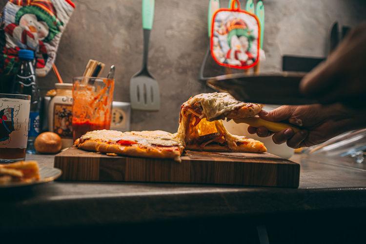 Person preparing food on cutting board