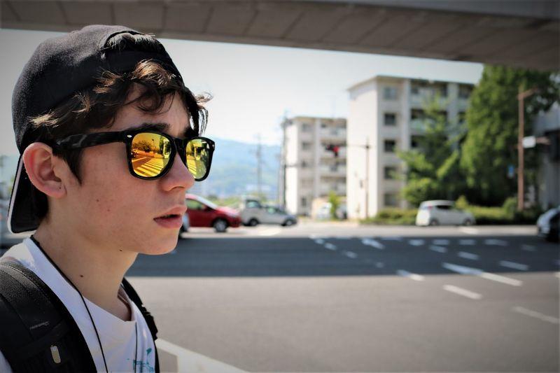 Boy Wearing Sunglasses In City