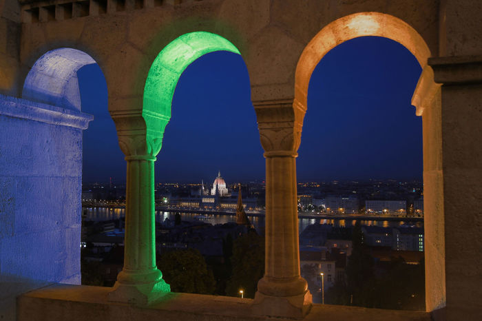 Budapest Castle Light View Arch Architectural Column Architecture Bluelight Budacastle Cib City Greenlight Night No People Orangelight Outdoors Parlament Parlament Of Hungary
