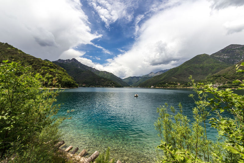 Lago di Ledro Lake Lake View Water Lago Di Ledro Ledrosee Alps Italy Clear Water Waterfront Cloud - Sky Sky Scenics - Nature Beauty In Nature Mountain Tranquility Tranquil Scene Plant Nature Tree Mountain Range Day Fisherman One Person Unrecognizable Person Turquoise Colored Non-urban Scene Idyllic Outdoors Green Color