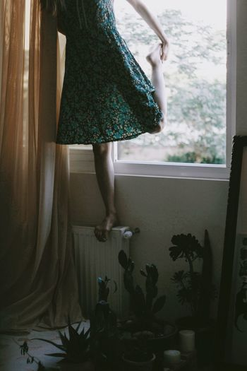 Dance baby, Dance. One Person Indoors  Standing Home Interior Low Section Women Curtain Dress Clothing Window Plant Fashion Human Limb Real People Lifestyles Human Body Part