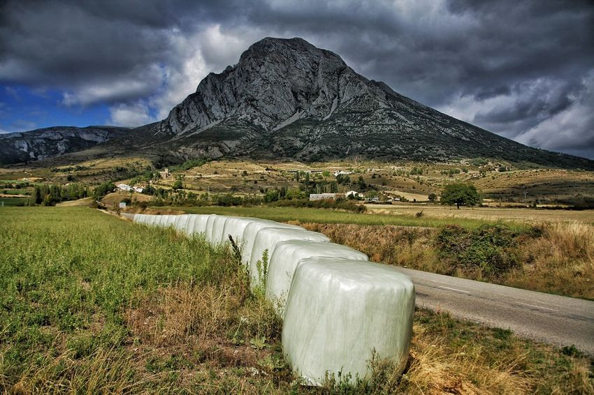 Mountain Spanish Pyrenees Basque Country Agriculture Grass Hay Bales Roadtrip Road Dark Clouds