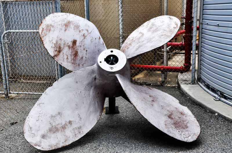 Large submarine propeller with four blades on display outside the Maritime Museum in Fremantle, Western Australia. Acceleration Blades Display Equipment Four Fremantle  Maritime Museum Metallic Naval Object Outdoors Propeller Propulsion Rusted Silver  Submarine Western Australia