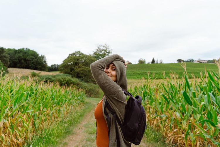 Man in field against sky