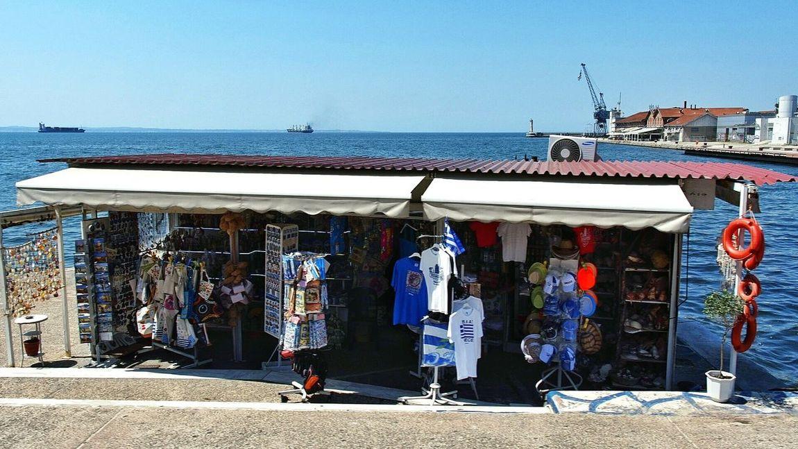 Taking Photos /Snapshots while walking along the quai! :1 on km 0,1 Souvenirs red Lifebelt Blue White t-shirt Buying Presents Writing Postcards