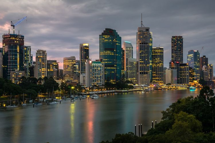 Brisbane Skyline at dusk, Brisbane, Queensland, Australia Architecture Skyscraper Building Exterior City Built Structure Sky Modern Cityscape Cloud - Sky Tower Illuminated Travel Destinations Waterfront Urban Skyline Water Outdoors No People Tall Growth Night