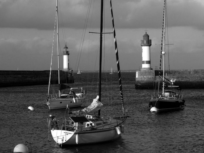 Bnw_shore_lighthouse Bnw_friday_eyeemchallenge Nautical Vessel Transportation Sea Harbour Lighthouse Water Travel Sailboat Mast Moored Pole