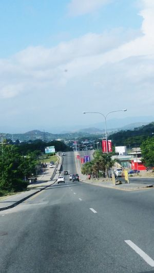 Taking Photos enjoying the ride with a friend How's The Weather Today? It's sunny day in Port Moresby