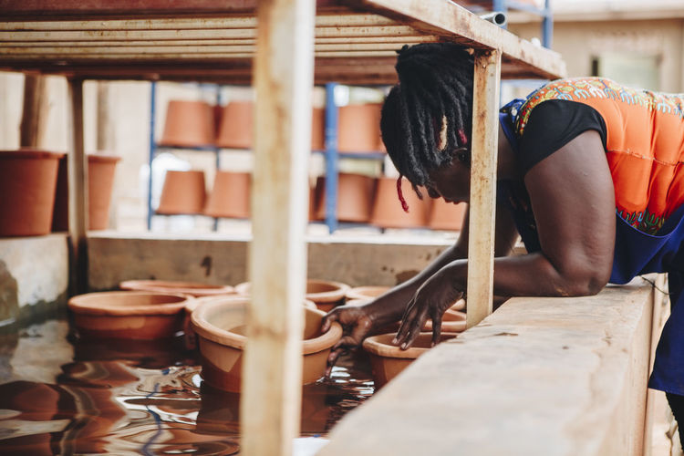 Adults Only Africa African Business Ceramic Clay Factory Filter Floating Health Manual Worker Manufacturing Pots Pottery Production Real People Social Business Terracotta Testing Warehouse Water Water Filter Woman Worker Working