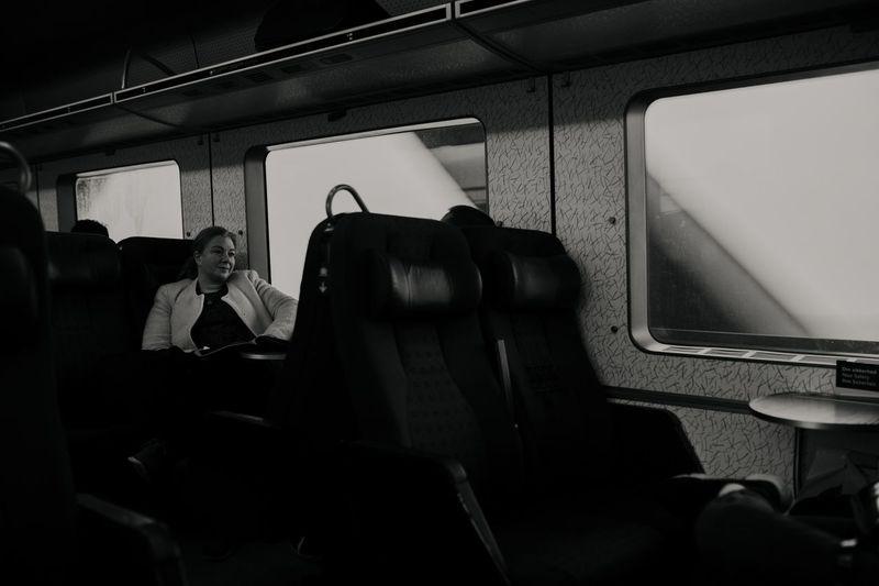Real People Street Photography Street Portrait Black And White Blackandwhite Vehicle Interior Transportation Mode Of Transportation Vehicle Seat Public Transportation Seat Travel Window Train Journey Rail Transportation Land Vehicle Train - Vehicle Sitting
