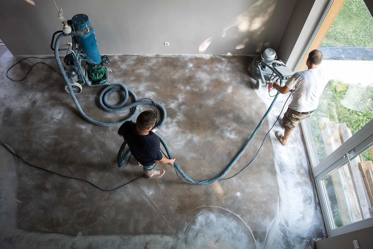 High angle view of men cleaning floor at home