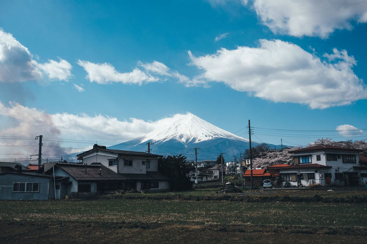 Cloud - Sky Architecture Sky Built Structure Building Exterior Mountain Building House Nature No People Scenics - Nature Residential District Day Beauty In Nature Snowcapped Mountain Outdoors Snow Mountain Range Landscape Mountain Peak Fuji
