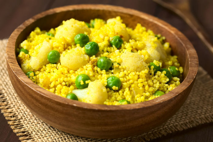 Curried couscous with peas, cauliflower, ginger and garlic served in wooden bowl, photographed with natural light (Selective Focus, Focus in the middle of the dish) Cereal Couscous Curry Dish Green Meal Salad Vegetarian Vegetarian Food Bowl Cauliflower Cooked Cruciferous Curried Food Food And Drink Freshness Grain Green Pea Healthy Healthy Eating Peas Vegan Vegetable Vegetarian Food