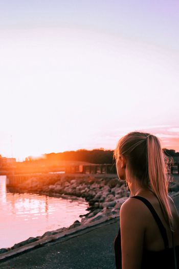 Harbor sunset EyeEm Selects Water Sky Sea Real People Lifestyles Women Sunset Young Women Nature Beach One Person Beauty In Nature Adult Leisure Activity Copy Space Outdoors Young Adult Hairstyle Hair Rear View