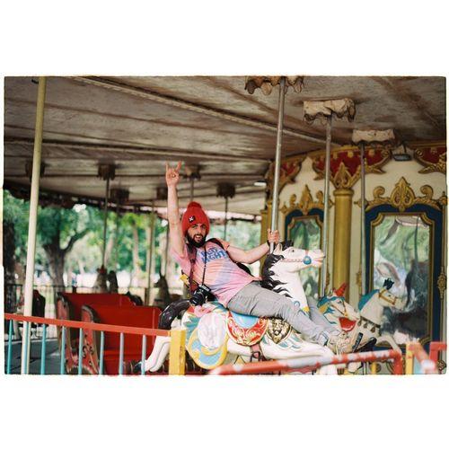 Man riding horses in amusement park