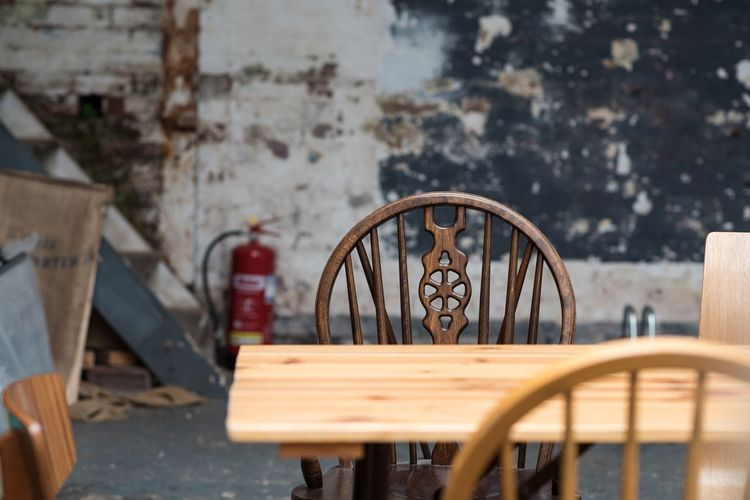 Close-up of chairs on table