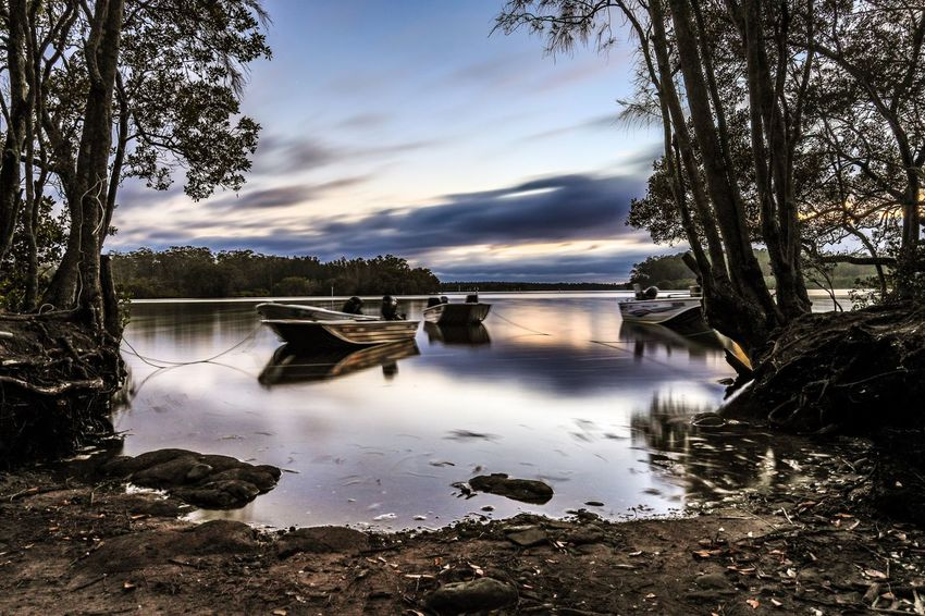 Fishing boats on country river surrounded by trees Nsw Scenic Ramp Morning Dawn Cloudy Clouds Calm Fishing Boat Water Trees Nature Landscape Australian Australia Karuah Water Tree Reflection Nature Sky Tranquility Beauty In Nature Tranquil Scene Day No People Scenics Lake Outdoors