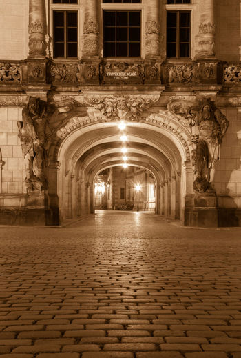 Cityscape Night Lights Night Photography Nightphotography Reflection Ancient Arch Architectural Feature Architecture Architecturelovers Building Exterior Built Structure Cobblestone History Illuminated Night Night View No People Outdoors Palace Sepia Street Streetphotography Travel Destinations Window