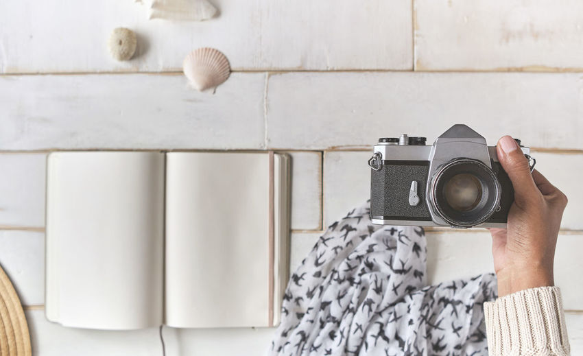 Man photographing with camera on wall