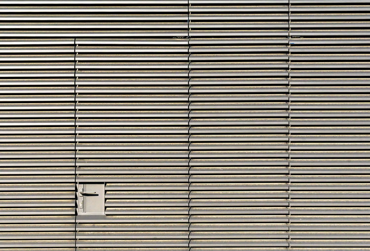 Corrugated Security Wall In A Row Building Exterior Wall - Building Feature Repetition Krull&Krull Architecture Architecture Modern Door Lines Day Minimalism Pattern Blinds Minimalistic Closed Indoors  Metal Minimalobsession Shutter Corrugated Iron Striped Close-up Textured  No People Backgrounds Minimalist Photography  Lines And Shapes Full Frame Built Structure The Architect - 2018 EyeEm Awards Textured  Krull&Krull Minimalistic