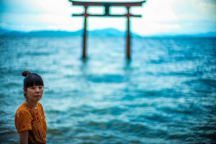 Japan Shiga Lake Biwa Lakeside Lake View Lake Shinto Shrine Archway TORII Woman Photographer Woman Portrait Woman One Person Real People Water Day Leisure Activity Nature Lifestyles Waist Up Standing Portrait Casual Clothing Outdoors Innocence