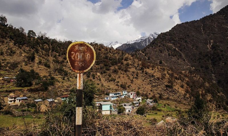 EyeEm Selects Mountain Nature Landscape Sky Tranquility No People Day Outdoors Beauty In Nature Mountain Range Scenics Cloud - Sky Tree India Himalayas Village Sign Marker