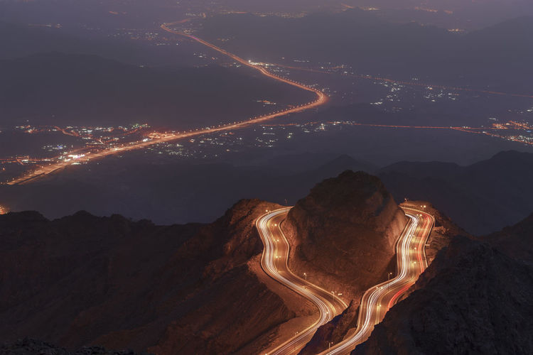 High angle view of illuminated road at night