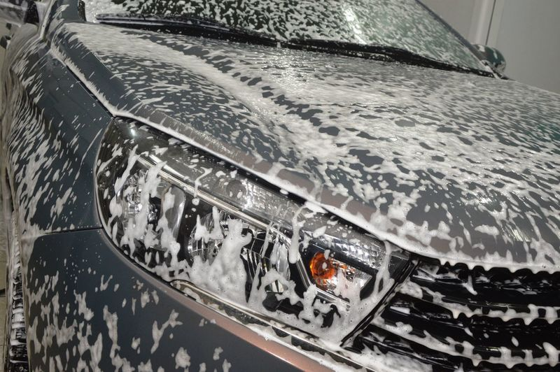 Close-up of wet car during winter