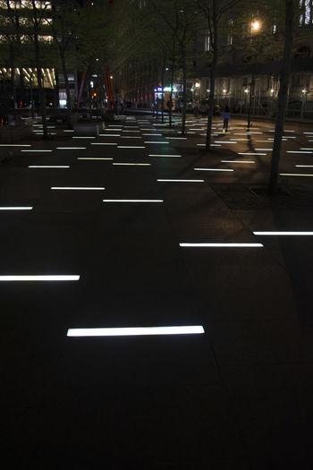 EyeEmNewHere New York City At Night Time New York Street Footpath Lighting Illuminated Lighting Effects Near Ground Zero